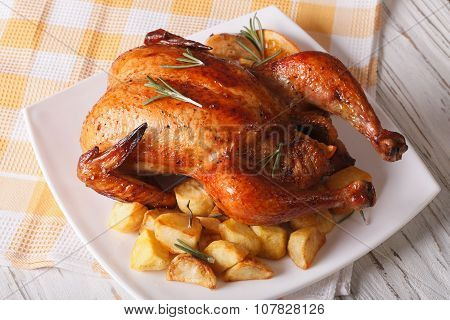 Roast Chicken With Oranges And Potato On A Plate. Horizontal