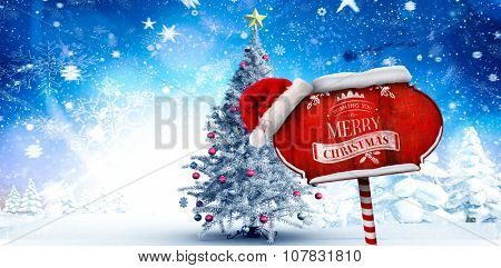 Christmas greeting against christmas tree in snowy forest