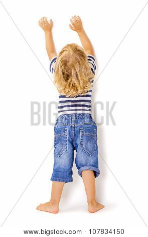 Back View of Little Boy with Hands Up