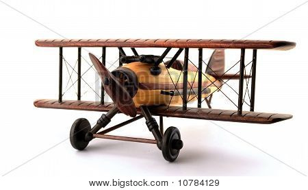 A model biplane in various shades of wood. Isolated on white. poster