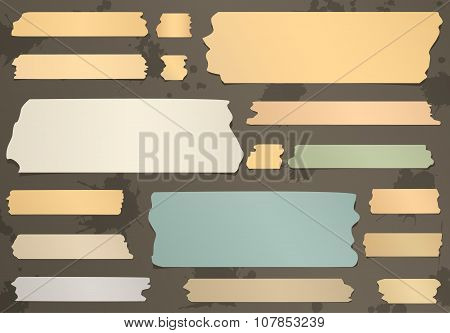 Set of horizontal and different size sticky tape, adhesive pieces on brown background