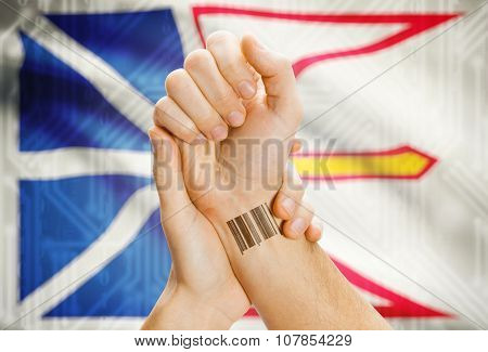 Barcode ID number tatoo on wrist and Canadian province flag on background - Newfoundland and Labrador poster
