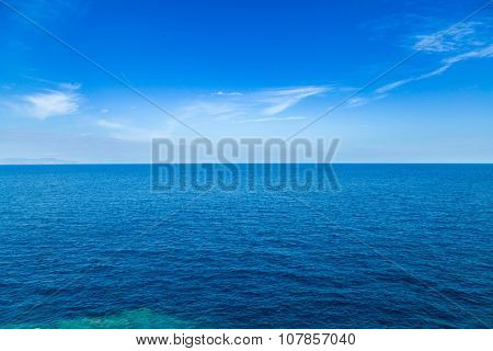 Blue sea waters and clear blue sky horizon
