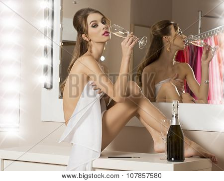 Sexy Girl Drinking Champagne In Bathroom
