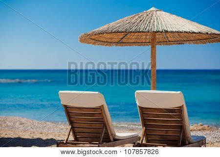 View Of The Beach With Chairs And Umbrellas