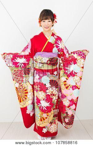 Beautiful asian kimono woman on white background