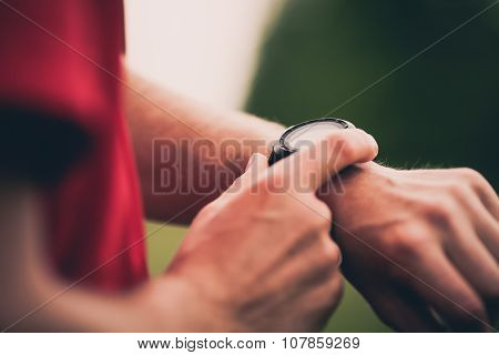 Runner Training And Using Heart Rate Monitor Smart Watch