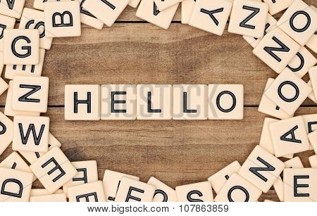 Hello spelled out in tan tile letters poster