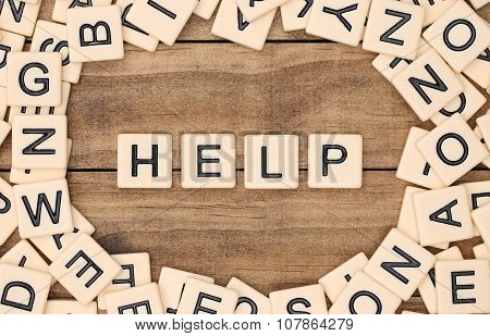 Help spelled out in tan tile letters poster