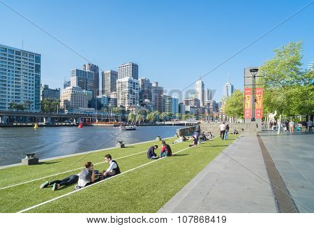 Southbank Promenade With People And Melbourne Skyline