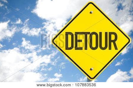 Detour sign with sky background