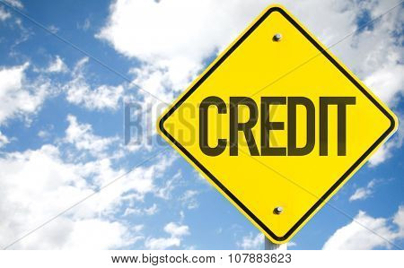 Credit sign with sky background