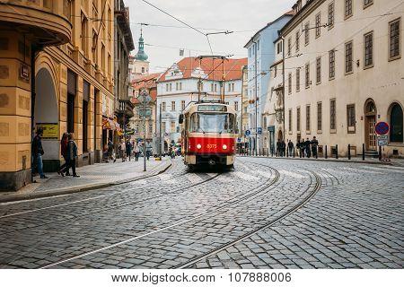 Movement of tram on the street Malostranske namesti in Prague, C
