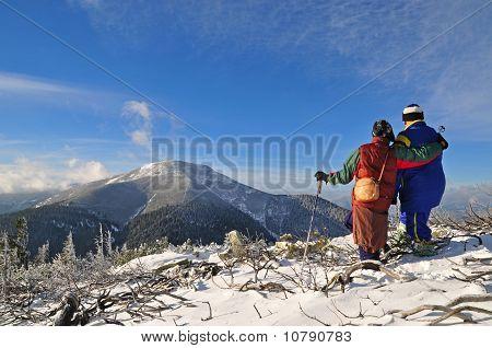 Tourists on a winter hillside