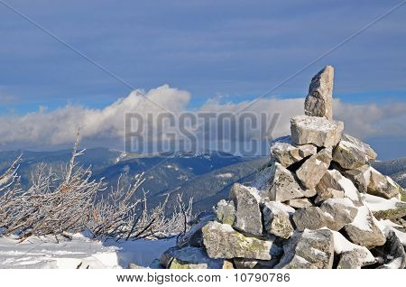 Pyramid from stones at mountain top.