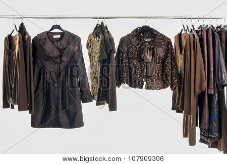 Variety of different clothes for females rack display