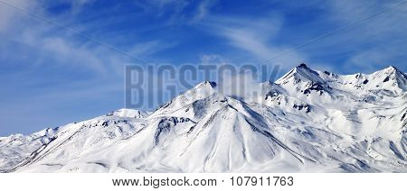 Panoramic View Of Winter Snowy Mountains At Windy Day