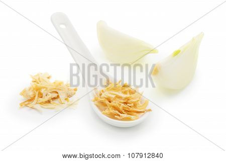 Dried Onions In A White Ceramic Spoon