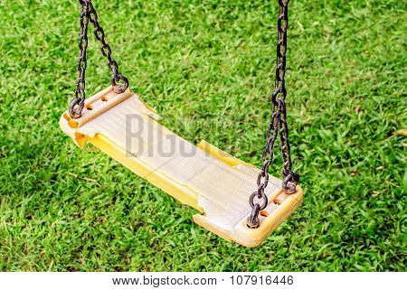 Musty hanging swing seats on park, Close up image poster