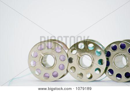 Three Small Spools Of Sewing Thread