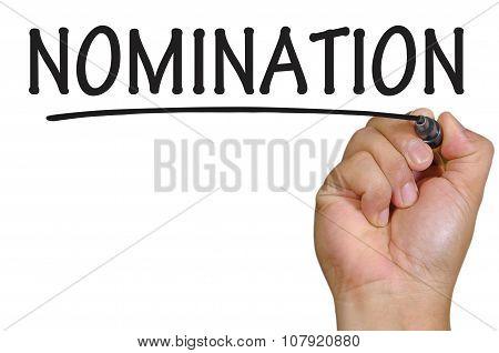 Hand Writing Nomination Over Plain White Background