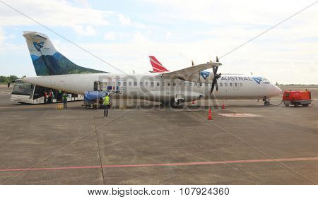 PLAINE MAGNIEN MAURICIUS - NOVEMBER 3, 2015: Maintainance unit preparing Aerospatiale/Alenia ATR 72 Air Austral for flight on SSR International Airport. Turbopropelled aircraft for 64 passengers.