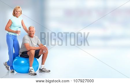 Senior healthy fitness couple. Over blue background
