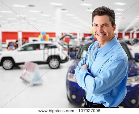 Car dealer man. Auto dealership and rental concept background.