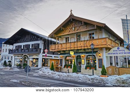 GARMISCH-PARTENKIRCHEN GERMANY - JANUARY 06 2015: Enchanting Upper Bavarian-styled homes in Garmisch-Partenkirchen beautifully decorated for the Christmas holidays