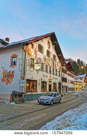 GARMISCH-PARTENKIRCHEN GERMANY - JANUARY 06 2015: Silver colored Opel parked in front of a house with lovingly painted facade. Garmisch-Partenkirchen a mountain resort in Bavaria southern Germany
