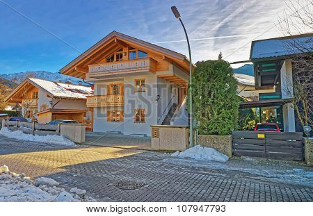 GARMISCH-PARTENKIRCHEN GERMANY - JANUARY 06 2015: Street with residential houses in Garmisch-Partenkirchen. It is a mountain resort town in Bavaria southern Germany in the heart of the Alps