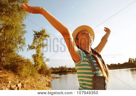 Happy Little Girl In A Hat With Open Arms