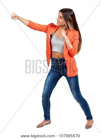 skinny woman funny fights waving his arms and legs. Isolated over white background. The girl in the red jacket standing in a boxing pose and hit his left hand.