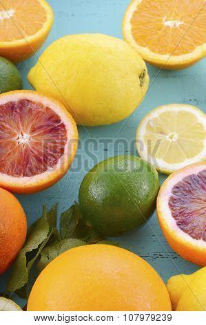 Citrus Fruit On Blue Wood Table.