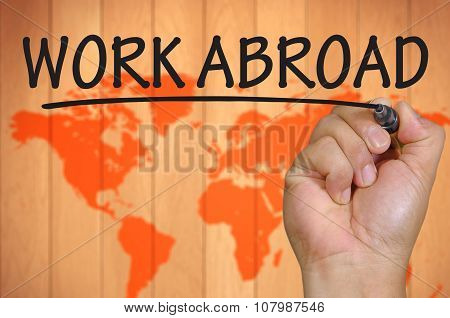 Hand Writing Work Abroad Over Blur World Background
