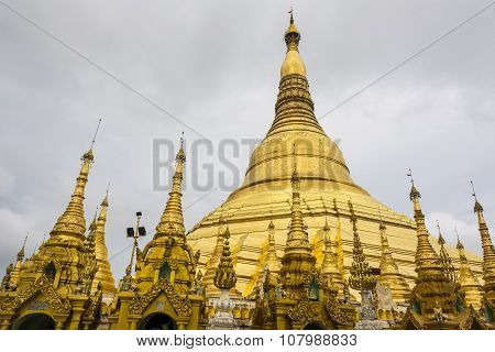 Shwedagon Pagoda In Rangoon With Temple Covered With Foil Gold