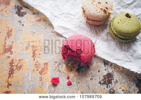 Overhead View Of Half Eaten Pink Macaroon