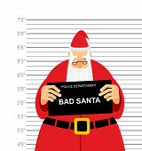 Mugshot is bad Santa. Arrested Sana Claus at police station holding a sign. Christmas offender in bruise under eye. His grandfather was detained for fight. poster