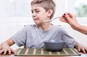 Picky eater boy refusing to eat disgusting food poster
