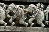 Asian elephants! Sculptures of Indian elephants at the Halebid temple in Karnataka in India poster