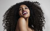 laughing woman with afro hair and strobing skin poster