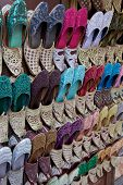 Arabian shoes on sale in a traditional souk in old Dubai, UAE. poster
