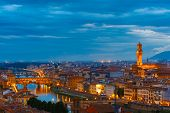 River Arno with bridge Ponte Vecchio and Palazzo Vecchio at night from Piazzale Michelangelo in Florence, Tuscany, Italy poster