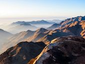 Spectacular aerial view of the holy summit of Mount Sinai, Aka Jebel Musa, 2285 meters, at sunrise, Sinai Peninsula in Egypt. poster
