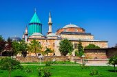 Tomb of Mevlana the founder of Mevlevi sufi dervish order with prominent green tower in Konya Turkey poster