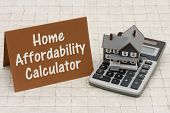Home Mortgage Affordability Calculator A gray house brown card and calculator on stone background with text Home Affordability Calculator poster