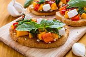 Italian Appetizer Bruschetta with roasted Pumpkin, Red Bell Pepper, Spinach, Garlic and Feta Cheese poster