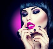 High Fashion Model Girl Portrait with Trendy fringe Hair style, Make up and Manicure. Black Hairstyle, Black Nail Polish and purple Lipstick. Woman Makeup. Sexy Lips. Bob Haircut poster