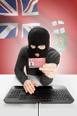 Hacker with ID card in hand and Canadian province flag on background - Manitoba poster