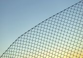 Background with chain link fence on blue sky poster